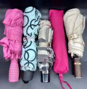 A selection of umbrellas some by Burberry