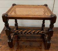 An oak barley twist stool with a cane seat (H49cm W50cm D38cm)