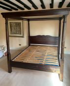 A mahogany four poster bed with slat frame base
