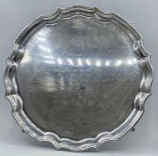 A Hallmarked silver tray, engraved on four feet, total weight 770g, Sheffield 1967