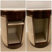 A pair of bespoke circular side tables with a marble top and brushed rose/copper style edging with