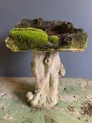 A woodland theme birdbath with sqaure water bath on a wooland theme base (H64cm)