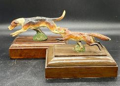 A cold painted bronze fox on wooden plinth and a cold painted bronze hound on a wooden plinth