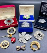 A selection of costume jewellery brooches.