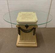 A Silik centre table on column base with a glass top