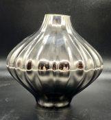 A small Jonathan Adler vase