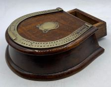 A Late 19th Century oak and brass horseshoe shaped cribbage board with card drawer