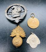 A selection of military badges and medallions to include: Fed Nat Le Des Maitres Briquetiers