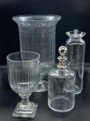 Four glass vessels, hurricane lamps, decanter etc