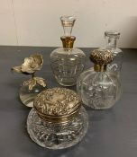 A selection of glass lidded dressing table bottles, two with silver lids