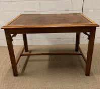 A leather top Edwardian coffee table (H48cm W68cm D49cm)