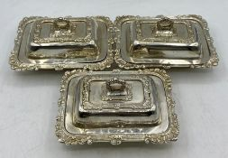 A set of three silver, hallmarked lidded small butter dishes, Birmingham 1935 by A Marston & Co (