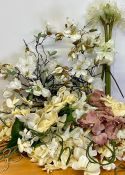 A large selection of silk faux flowers, mainly orchids