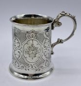 A silver tankard, engraved, hallmarked Sheffield 1864. Makers name Henry Wilkinson & Co. (129g)