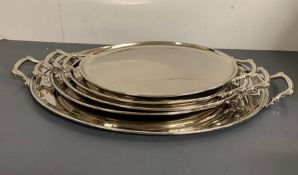 Five white metal two handle trays