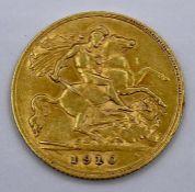 A 1910 22ct half sovereign coin.