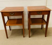 A pair of bedside cabinets with shelf under on square tapered legs