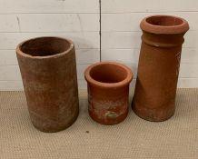 Three terracotta chimney pots, various sizes (Tallest H63cm)
