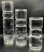 Three decorative glass pillars (H55cm tallest)