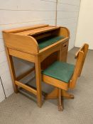 A vintage children's roll top desk and matching chair by Taylor England (H80cm W70cm D44cm)