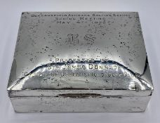 A Hallmarked silver engraved cigarette box.