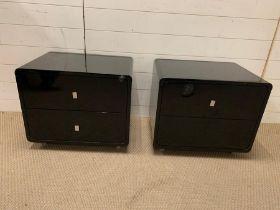 A pair of black lacquer bedsides (H47cm W56cm D42cm)