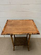 A cane side table with shelf under (H73cm W56cm D40cm)