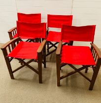 Four folding directors chairs