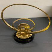 A gilt metal sculpture on base (H35cm W39cm)