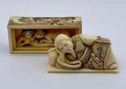 A carved and decorated erotic Japanese netsuke