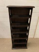 A carved top narrow open shelving unit (H100cm W41cm D19cm)