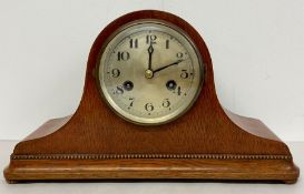 An Eight Day dome top mantle clock