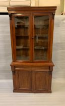 A mahogany glazed bookcase with drawer and cupboard under (H206cm W103cm D39cm)