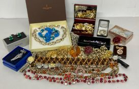 A selection of costume jewellery including some watches.