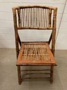 A bamboo and cane folding chair