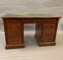 A pedestal desk with green leather top (H76cm W126cm D60cm)