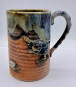 An Oriental studio mug depicting a man.