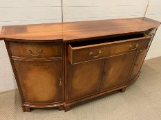 A mahogany sideboard with string inlaid and brass handles (H88cm W169cm D42cm)