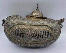 An Antique heavily engraved Persian camel flask.