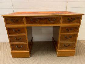 A pedestal desk with oxblood red leather top AF