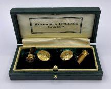 A Pair of Holland & Holland 18ct gold shotgun cartridge cuff links in original box.