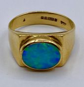 An Opal ring in a contemporary 9ct gold setting (4g) Size L & 1/2