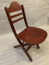 A folding wooden chair
