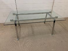 A glass and chrome coffee table (H46cm W120cm 72cm)