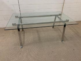 A glass and chrome coffee table (H46cm W120cm 72cm)