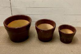 Three glazed garden pots
