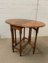 A small drop side occasional table (H74cm W90cm)
