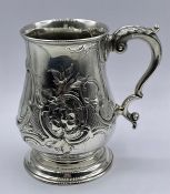 A Victorian ornate silver tankard Hallmarked London 1869 RH makers mark, Robert Harper.(Total Weight