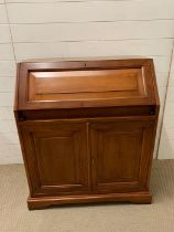 A bureau, fall front opening to reveal pigeon holes and drawers (H101cm W85cm D45cm)