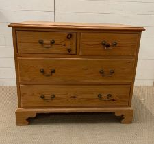 A pine chest of drawers on bracket feet, two short over two long (H76cm W90cm D48cm)